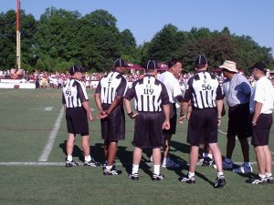 Coach Zorn and the officials at practice.