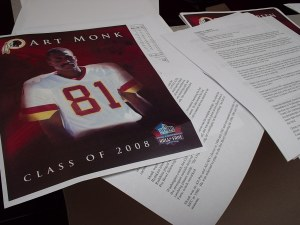 Hall of Fame info packets being assembled.