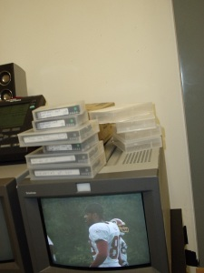 Monitor showing Santana Moss.  Also, tapes.