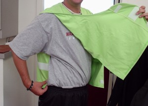 Side of vest with velcro closures, demonstrated flight attendant style.
