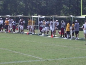 Players under the shade during practice.