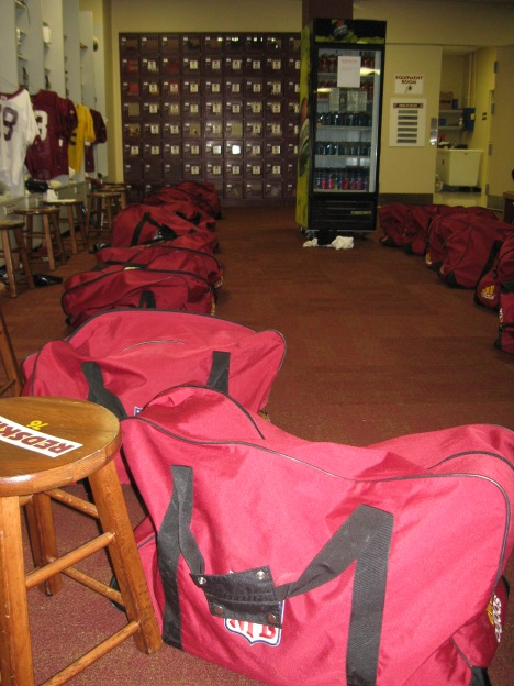 Bags packed and ready in front of lockers.