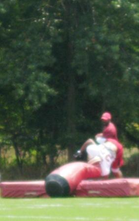 This is Mason upside-down post-tackle.  Apologies for blurriness due to distance and Mason's speed in the approach.
