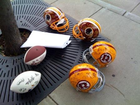 Soon-to-be-signed memorabilia on the sidewalk in Charlotte, waiting for players to walk by.